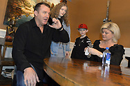 CHICAGO - JANUARY 24:  Former Major League player Jim Thome receives a phone call from the National Baseball Hall of Fame in Cooperstown, New York, informing him that he has been elected to the Hall of Fame. Jim accepted the call while surrounded by his family, wife Andrea and children Lila Grace and Landon. (Photo by Ron Vesely)  Subject: Jim Thome