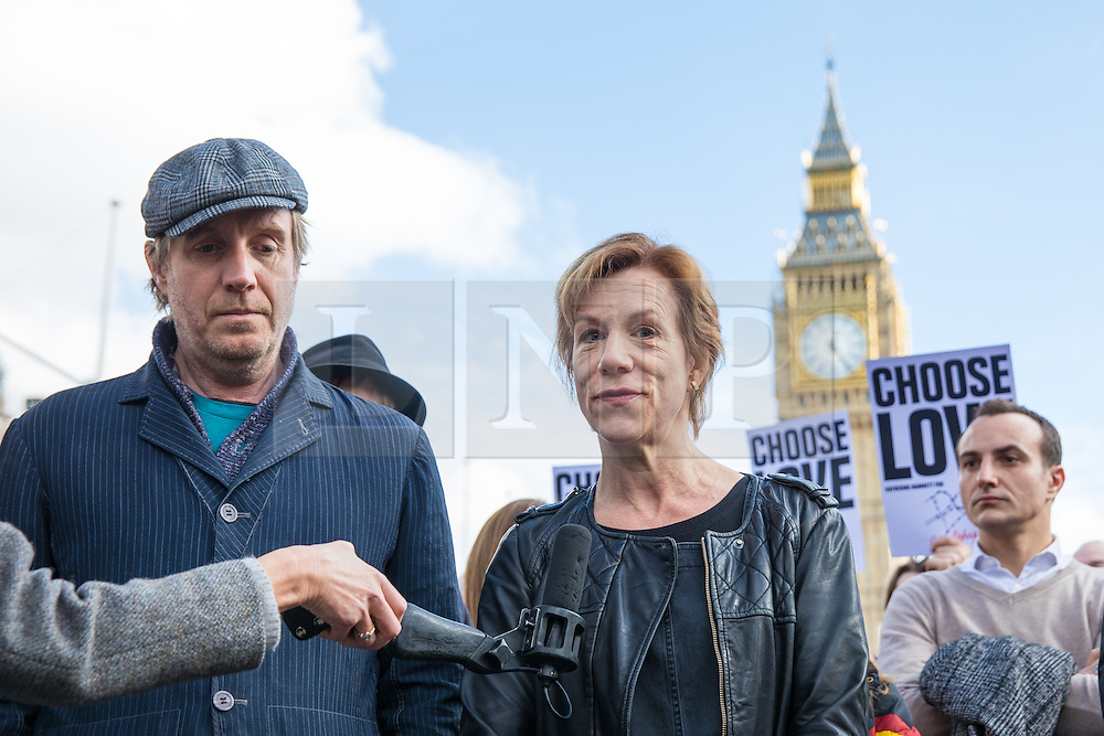 © Licensed to London News Pictures. 07/03/2017. London, UK. Actress Juliet Stevenson (C) and actor Rhys Ifans (L) join campaigners in Parliament Square to call on the government to reinstate the Dubs amendment. The Dubs Amendment, which was introduced by Lord Dubs who was brought to Britain as a child on the Kindertransport and aims to bring child refugees to safety in Britain, was suspended by the government in February 2017. Photo credit: Rob Pinney/LNP