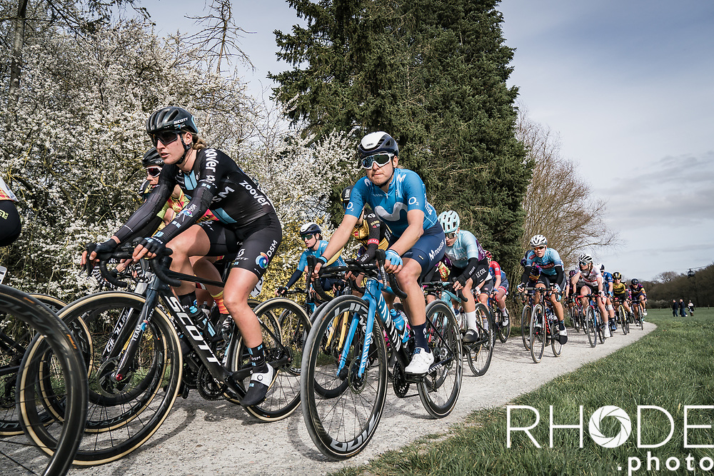peloton riding the plugstreets (gravel / grind section)<br /> <br /> 10th Gent-Wevelgem in Flanders Fields 2021<br /> Elite Womens Race (1.WWT)<br /> <br /> One Day Race from Ypres (Ieper) to Wevelgem 142km<br /> <br /> ©RhodePhoto