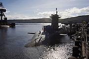 HMS Vigilant, a 15,000 ton Vanguard class nuclear submarine docked at HM Naval Base Clyde, Faslane, Scotland.