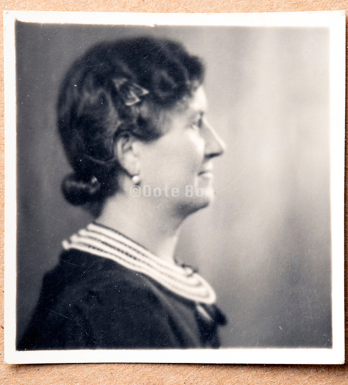 side view portrait of an adult woman ca 1930s