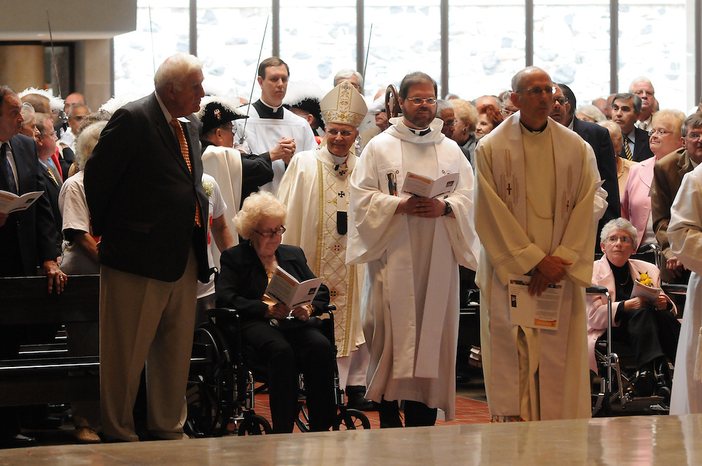 Nearly 350 couples celebrating their 50th wedding anniversary in 2010 attend a mass in their honor at St. John Brebeuf Parish in Niles. The Golden Jubiliarian couples will lead in a renewal of their wedding vows by the Francis Cardinal George (center).