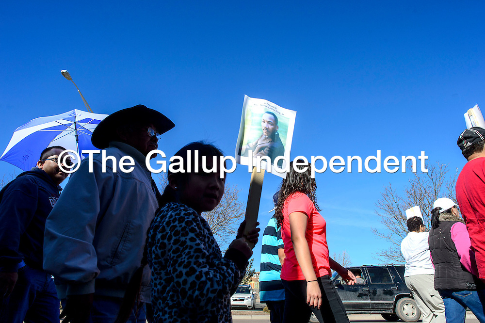 011915  Adron Gardner/Independent<br /> <br /> Marchers make their way down Historic Highway 66 during the Martin Luther King Day march in Gallup Monday