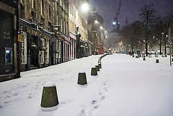 Edinburgh, Scotland, UK. 10 Feb 2021. Big freeze continues in the UK with heavy overnight and morning snow in the city. Pic; Easily morning in a snow covered Grassmarket.  Iain Masterton/Alamy Live news
