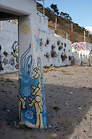 Street art grafitti on ruin building at Killiney Beach in Dublin Ireland