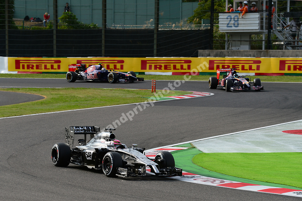 Jenson Button (McLaren-Merdedes) in front of Toro Rosso-Renault drivers Jean-Eric Vergne and Daniil Kvyat during qualifying for the 2014 Japanese Grand Prix in Suzuka. Photo: Grand Prix Photo