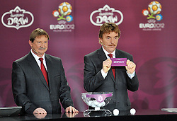 (L) ANDRZEJ SZARMACH AND (R) ZBIGNIEW BONIEK (BOTH POLAND) SHOW THE TICKET OF GERMANY DURING THE EUFA EURO 2012 QUALIFYING DRAW IN PALACE SCIENCE AND CULTURE IN WARSAW, POLAND..THE 2012 EUROPEAN SOCCER CHAMPIONSHIP WILL BE HOSTED BY POLAND AND UKRAINE...WARSAW, POLAND , FEBRUARY 07, 2010..( PHOTO BY ADAM NURKIEWICZ / MEDIASPORT / SPORTIDA.COM ).