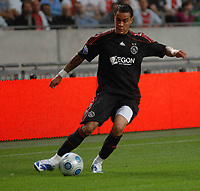 Amsterdam The Netherlands 24 July 2009: Amsterdam Tournament Ajax vs Atletico Madrid. The game ends ina 3-3 draw. Gregory van der Wiel on the ball for Ajax. 24/07/2009 Credit Colorsport / Richard Wareham