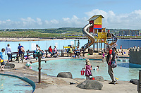 GV, general view, children's play area, Arcadia, Portrush, Co Antrim, N Ireland, UK, pool, bathers, 201406213171<br /> <br /> Copyright Image from Victor Patterson, 54 Dorchester Park, Belfast, UK, BT9 6RJ<br /> <br /> t1: +44 28 9066 1296 (from Rep of Ireland 048 9066 1296)<br /> t2: +44 28 9002 2446 (from Rep of Ireland 048 9002 2446)<br /> m: +44 7802 353836<br /> <br /> victorpattersonbelfast@gmail.com<br /> www.victorpatterson.com<br /> <br /> Please see my Terms and Conditions of Use at http://www.c1382010.myzen.co.uk/pdf/Terms%20&%20Conditions.pdf  It is IMPORTANT that you familiarise yourself with them.<br /> <br /> Images used on the Internet incur an additional cost and must be visibly watermarked i.e. ©Victor Patterson within the body of the image and copyright metadata must not be deleted. Images used on the Internet have a size restriction of 4kbs and are chargeable at rates available at victorpattersonbelfast@gmail.com.<br /> <br /> This image is only available for the use of the download recipient i.e. television station, newspaper, magazine, book publisher, etc, and must not be passed on to any third party. It is also downloaded on condition that each and every usage is notified within 7 days to victorpattersonbelfast@gmail.com.<br /> <br /> The right of Victor Patterson to be identified as the author is asserted in accordance with The Copyright Designs And Patents Act (1988). All moral rights are asserted.