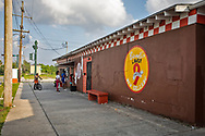 People buying food to go at Burnell's Lower 9th Market in New Orleans which remains open despite the coronavirus pandemic..