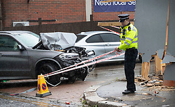 © Licensed to London News Pictures. 14/07/2019. London, UK. Police tape off the area around a damaged BMW X5 car in Battersea, south west London after a car was driven into a group of people leaving a hotel. Three men have been arrested on suspicion of murder after the incident which took place at 11. 15pm on Saturday night. One man has a broken leg and six other people also sustained minor injuries. Photo credit: Peter Macdiarmid/LNP