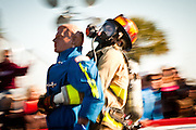 A woman firefighter carries a 175-pound mannequin backwards about 100 feet, all while wearing full firefighting gear and working against the clock during the international finals of the Firefighter Combat Challenge on November 18, 2011 in Myrtle Beach, South Carolina.