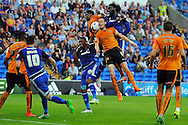 Wolves captain Richard Stearman (5) is challenged for a header by Cardiff City's Kenwyne Jones (r) and Kagisho Dikgacoi.  Skybet football league championship match, Cardiff city v Wolverhampton Wanderers at the Cardiff city stadium in Cardiff, South Wales on Saturday 22nd August 2015.<br /> pic by Carl Robertson, Andrew Orchard sports photography.