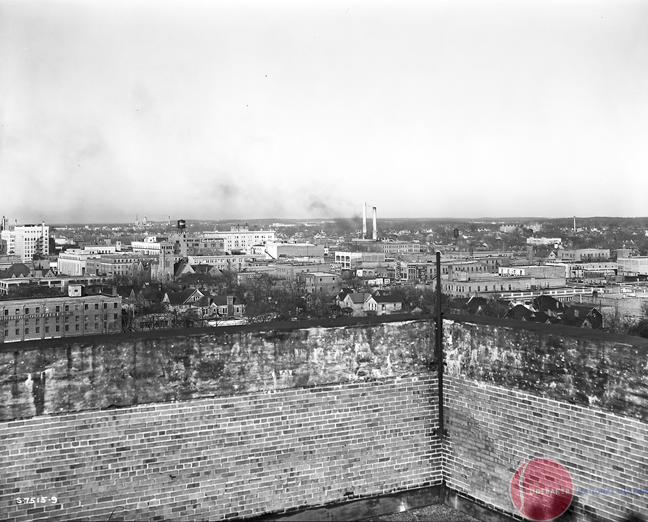 This 1941 image was taken from the roof of Studebaker building #84 and faces northwest.  South Bend's Robertson's Department Store water tower is visible.
