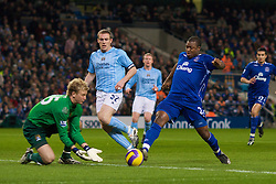 MANCHESTER, ENGLAND - Monday, February 25, 2008: Everton's Yakubu Ayegbeni and Manchester City's goalkeeper Joe Hart and Richard Dunne during the Premiership match at the City of Manchester Stadium. (Photo by David Rawcliffe/Propaganda)