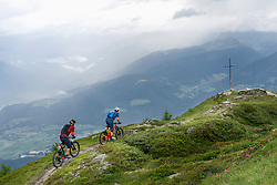 Mountain bikers riding uphill, Trentino-Alto Adige, Italy