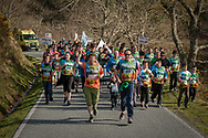"""People run on the 20th Korrika. Erratzu (Basque Country) April 3, 2017. The """"Korrika"""" is a relay course, with a wooden baton that passes from hand to hand without interruption, organised every two years in a bid to promote the basque language. The Korrika runs over 11 days and 10 nights, crossing many Basque villages and cities, totalling some 2300 kilometres. Some people consider it an honour to carry the baton with the symbol of the Basques, """"buying"""" kilometres to support Basque language teaching. (Gari Garaialde / Bostok Photo)"""