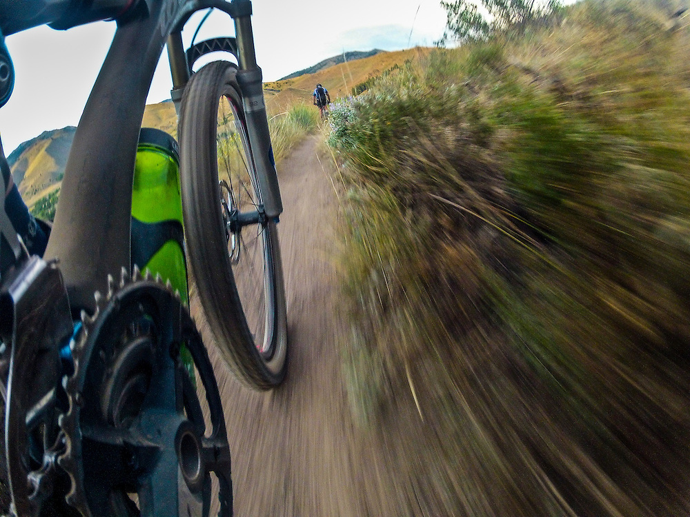 Mountain Bike Frame and wheel angle with camera mounted low for forward rider on Idaho Single Track Mountain Bike Trail near Ketchum.  Licensing and Open Edition Prints.