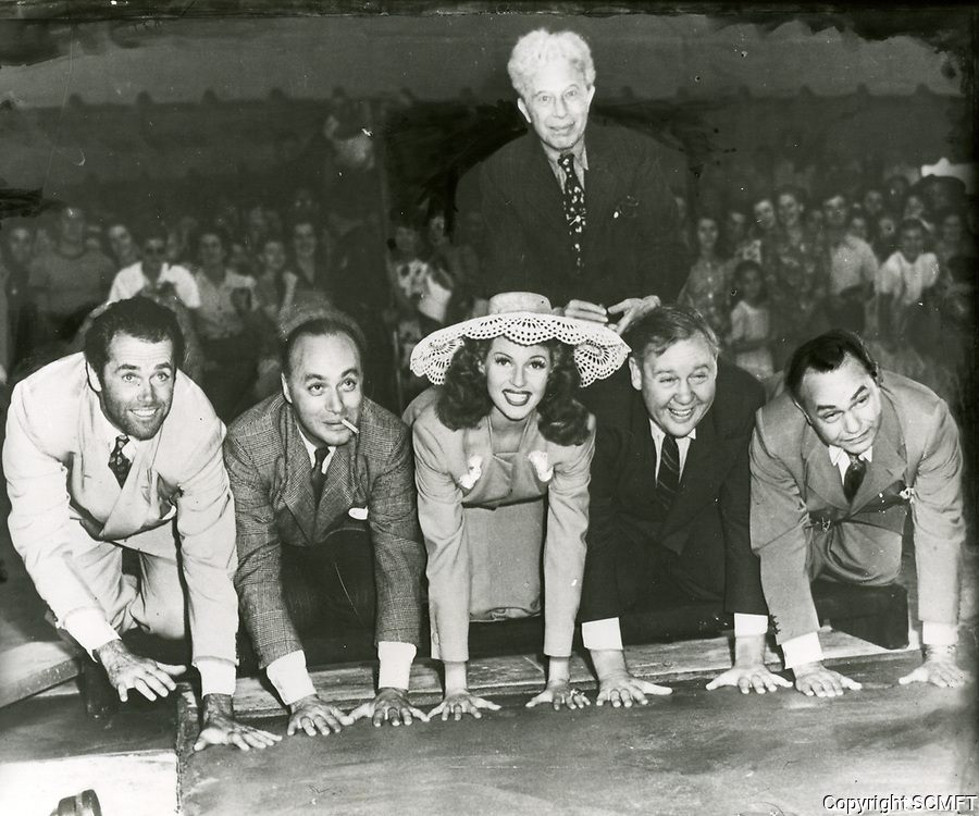 Sid Grauman with Edward G Robinson at hand/footprint ceremony at the Chinese Theater