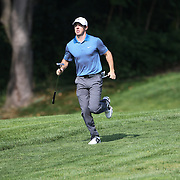 Rory McIlroy runs back to his group during the ProAm at The Barclays Golf Tournament at The Ridgewood Country Club, Paramus, New Jersey, USA. USA. 20th August 2014. Photo Tim Clayton
