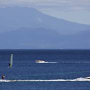 A wide view of Lake Taupo showing water skiing, Windsurfing and a motor boat on the water. Taupo, New Zealand,, 8th January 2011. Photo Tim Clayton.