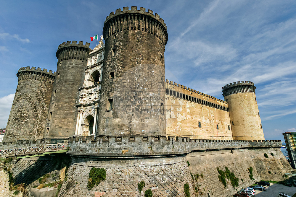 Castel Nuovo often called the Maschio Angioino is a medieval castle located in front of the Piazza Municipio in Naples, southern Italy. First erected in 1279, one of the main architectural landmarks of the city. It was a royal seat for kings of Naples, Aragon and Spain until 1815. The imposing single-sided white marble triumphal arch, built in 1470, commemorates Alfonso of Aragon's entry to Naples in 1443. It stands between two western Towers of the Angevin castle.