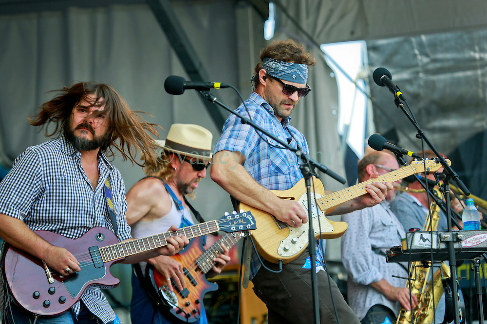 25 April 2014. New Orleans, Louisiana.<br /> The Honey Island Swamp Monsters play the New Orleans Jazz and Heritage Festival. <br /> L/R; Chris Mulé, Aaron Wilkinson and Sam Price.<br /> Photo; Charlie Varley/varleypix.com