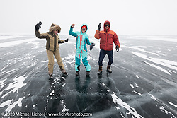 Sean Lichter with Oksana Voevodina and a friend dancing in the middle of Lake Baikal after the Baikal Mile Ice Speed Festival. Maksimiha, Siberia, Russia. Sunday, March 1, 2020. Photography ©2020 Michael Lichter.