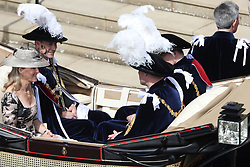 The Duke of York (right), the Duke of Cambridge (2nd right), the Earl of Wessex (2nd left) and the Countess of Wessex (left) ride in a carriage during the annual Order of the Garter Service at St George's Chapel, Windsor Castle.