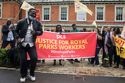 Royal Parks workers outsourced via French multinational VINCI Facilities dance on the picket line outside the Old Police House in Hyde Park during joint strike action by the United Voices of the World UVW and Public and Commercial Services PCS trade unions on 30th July 2021 in London, United Kingdom. The joint strike, with members dual carding over pay, conditions and the sacking of a member of staff, is believed to be the first between a TUC and a non-TUC trade union and follows the launch of a legal challenge by the Royal Parks workers against indirect racial discrimination by the Royal Parks.