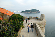 View from wall of Dubrovnik old town, with tower and island of Lokrum in background. Dubrovnik, Croatia