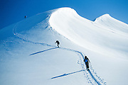 Alaska . Backcountry skiers at Turnagain Pass in southcentral winter .