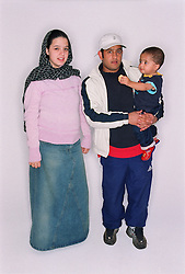 Young mother and father standing together with baby son,