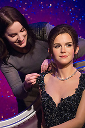 © licensed to London News Pictures. London, UK 26/03/2013. Wardrobe assistant Luisa Compobasai adding the last touches to a new wax figure of Emma Watson at Madame Tussauds London on Tuesday 26 March 2013. Photo credit: Tolga Akmen/LNP