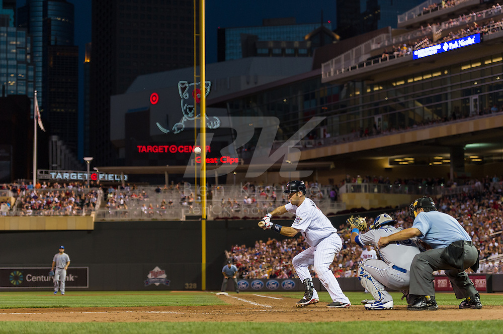 Joe Mauer #7 of the Minnesota Twins attempts to put down a bunt against the Kansas City Royals on June 27, 2013 at Target Field in Minneapolis, Minnesota.  The Twins defeated the Royals 3 to 1.  Photo by Ben Krause