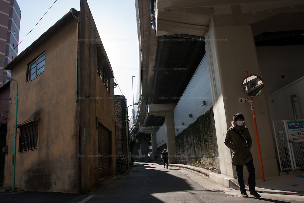 Houses in small streets near an expressway overpass in Hiroo, Tokyo, Japan. Friday February 3rd 2012