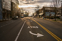 The central commercial district of West Seattle is relatively empty about an hour before sundown. (March 22, 2020).