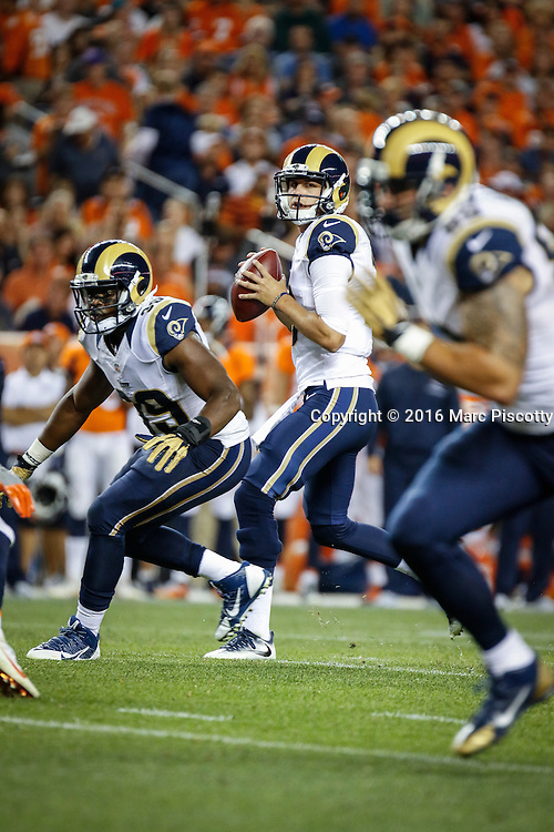 Los Angles Rams rookie quarterback and first overall NFL draft pick Jared Goff (#16) drops back to pass while playing against the Denver Broncos at Sports Authority Field at Mile High in Denver, Co. August 27, 2016. (Photo by Marc Piscotty / © 2016)