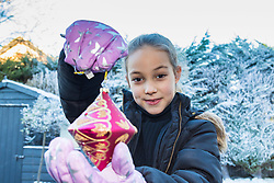 Tunbridge Wells, December 16 2017. Winner of the TK Maxx White Christmas promotion enjoy a day of fun in the snow, after aunt Helen Haggertay found one of the 'snow globes' in TK Maxx in Tunbridge Wells and gifted it to her sister Louise and niece Sofia Migliaccio. An exciting day ensued after several tons of snow were delivered BY TK Maxx and friends arrived to enjoy the day. PICTURED: Sofia Migliaccio, 9