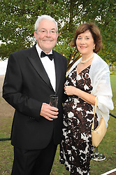 PETER ELLWOOD Chairman of the Royal Parks Advisory Board and his wife JUDY at the Royal Parks Foundation Summer Party hosted by Candy & Candy on the banks of the Serpentine, Hyde Park, London on 10th September 2008.