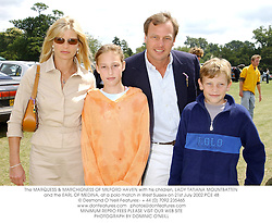 The MARQUESS & MARCHIONESS OF MILFORD HAVEN with his children, LADY TATIANA MOUNTBATTEN and the EARL OF MEDINA, at a polo match in West Sussex on 21st July 2002.	PCE 48
