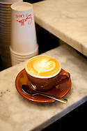 Spella Caffe, a tiny, Italian style coffee shop in downtown Portland, Oregon specializes in traditional espresso and espresso drinks using their own roasted coffee beans.  Pictured here is a classic cappuccino.