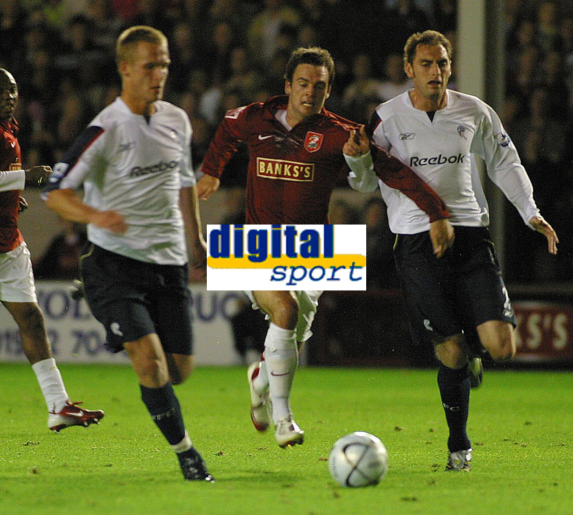 Photo: Dave Linney.<br />Walsall v Bolton Wanderers. Carling Cup. 19/09/2006.<br />Walsalls Daniel Fox(C) gets the better of the Bolton defence.