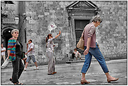 Day Tripper - DUBROVNIK is a selecvtive colour street photography series by photographer Paul Williams taken in 27th May 2009 of tourists visiting Dubrovnik in the summer.