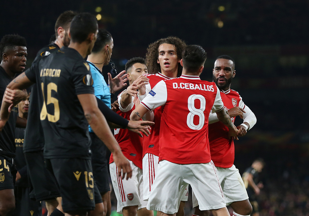 Arsenal's Matteo Guendouzi holds back Alexandre Lacazette after he was failed by Vitoria's Victor Garcia <br /> <br /> Photographer Rob Newell/CameraSport<br /> <br /> UEFA Europa League group F - Arsenal v Vitoria Guimaraes - Thursday 24th October 2019  - Emirates Stadium - London<br />  <br /> World Copyright © 2018 CameraSport. All rights reserved. 43 Linden Ave. Countesthorpe. Leicester. England. LE8 5PG - Tel: +44 (0) 116 277 4147 - admin@camerasport.com - www.camerasport.com