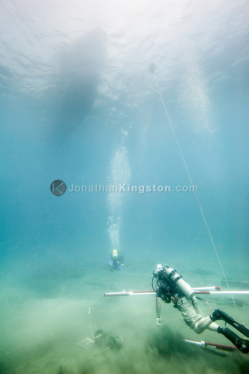 Two SCUBA divers set up a grid to begin mapping the Encarnación, a 17th century shipwreck discovered during an expedition looking for Henry Morgan's lost fleet of 1671 in Panama.