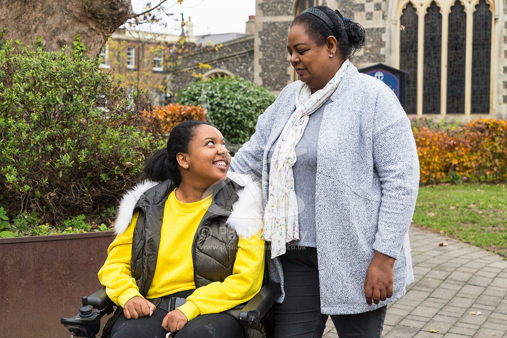 Mimi Tebeje and her disabled daughter Ruth in High Barnet, as Ruth heads for her course at Barnet and Southgate College. Unable to find suitable housing that can accommodate Ruth's disability and care needs, the pair have been living at Barnet Hospital for months. High Barnet, London, November 15 2018.