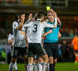 Ayr United's player manager Mark Kerr gets a yellow card from ref Aitken after his tackle on Dundee United's Sam Stanton for their penalty. Dundee United 4 v 0 Ayr United, Scottish Championship game played 21/12/2019 at Dundee United's stadium Tannadice Park.