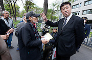 "Taro Fuchigami (in baseball cap) talks with a Ministry official outside the METI building in Kasumigaseki, Tokyo, Japan. Friday April 12th 2013. The camp has been in place since September 2011 resisting several attempts to remove it. It now faces a court order restricting access and protestors have been served with a order to pay ""rent"" for their use of the land."