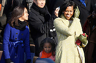 Malia and her mother Michelle holding the Lincoln Bible at the swearing in ceremony during the Inauguration on January 20, 2009.  Photograph:  Dennis Brack